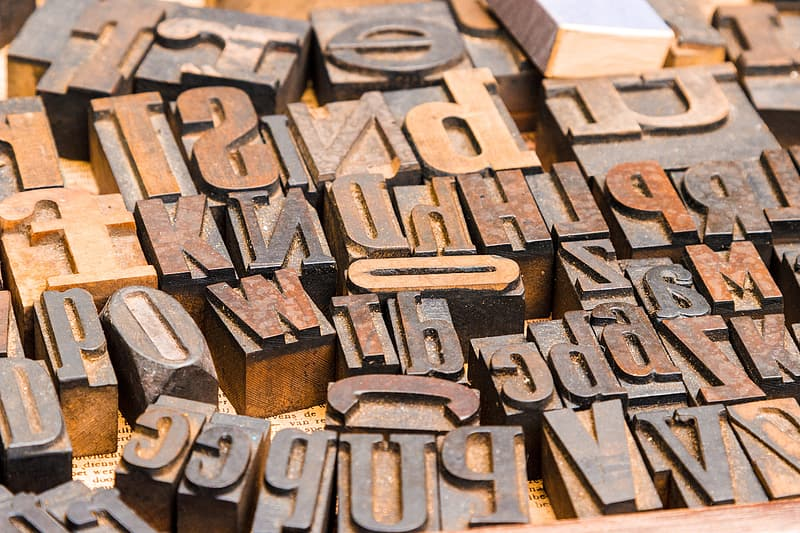 Brown wooden letter blocks on brown wooden table