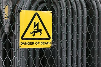 Selective focus photography of Danger of Death electric shock signage