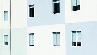 White and gray painted building with glass windows