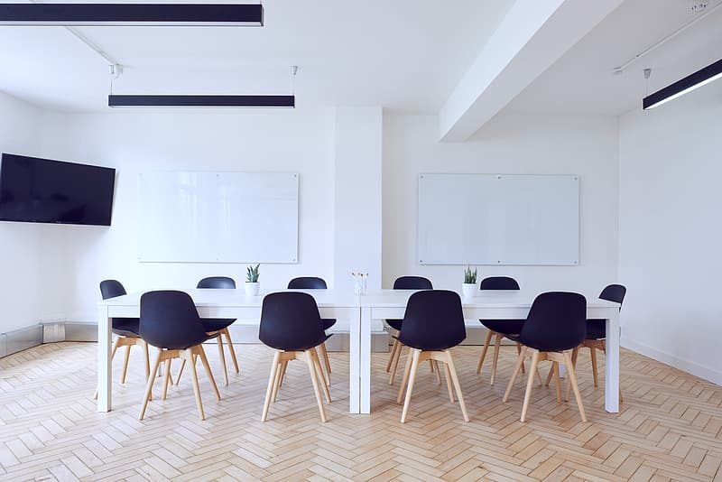 Rectangular long white table with chairs