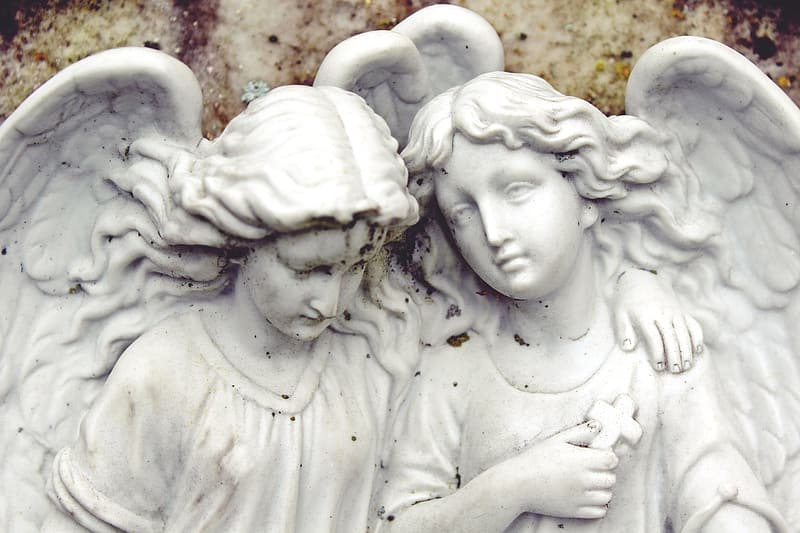 White ceramic angels statue