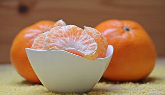 Orange fruit on ceramic bowl