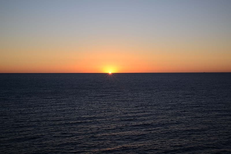 Sea with sunset background