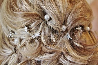 Woman's hair with white beads
