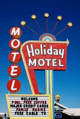 Holiday Motel neon sign under calm sky