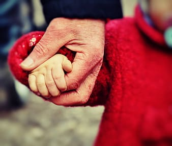 Selective photography of person holding hands