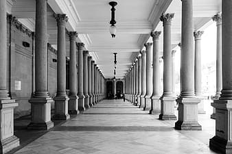Grayscale photo of hallway with light