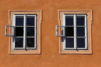 Two white wooden window frames