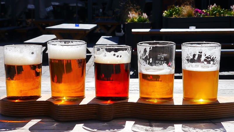Five clear beer glasses on table