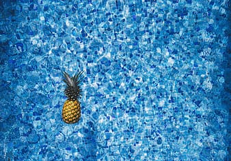 Pineapple floating on body of water