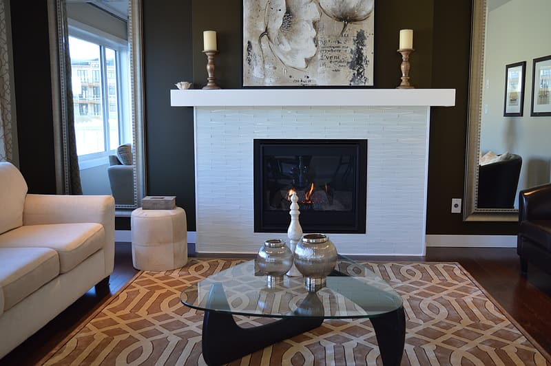 Glass-top table near fireplace