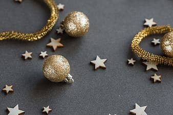 Gold and silver baubles on gray textile