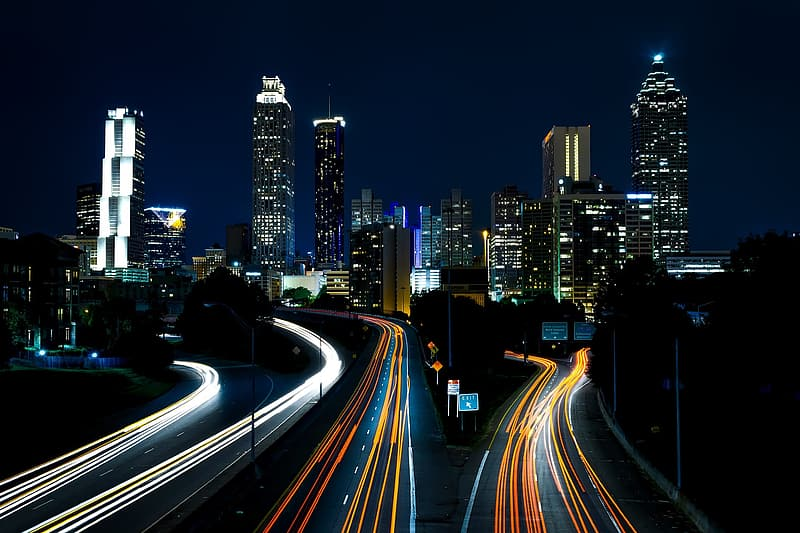 Timelapse photography of car lights on city during night time