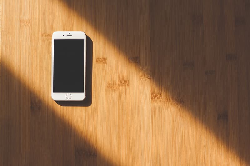 Silver iphone 6 on brown wooden table