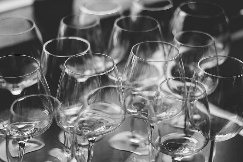 Grayscale photo of clear wine glasses