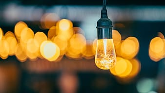 Bokeh photography of yellow light bulb