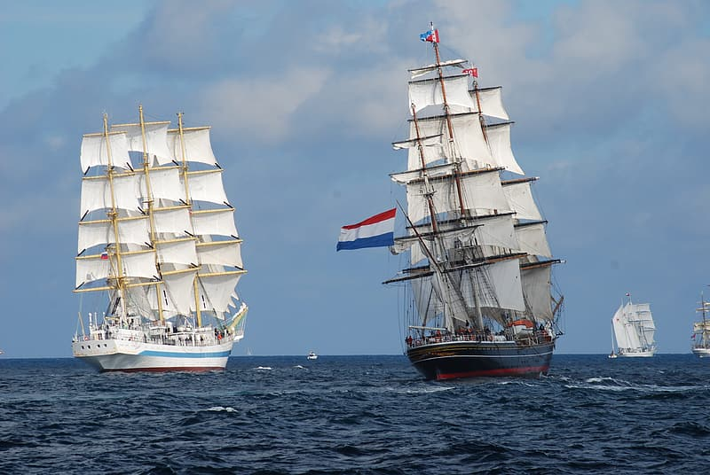 Photo of two white and blue Sail Ship