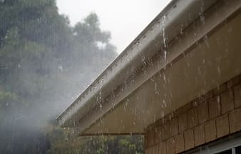 Rainwater dripping on house roofs