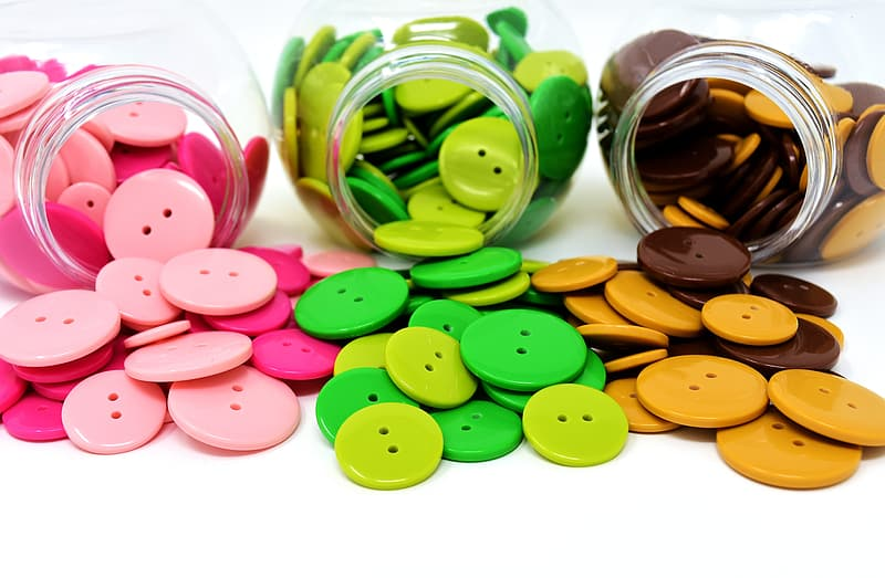 Green and pink round candies