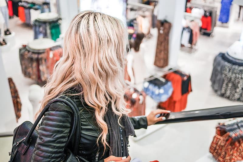 Young Blonde Girl Shopping at the Clothing Store