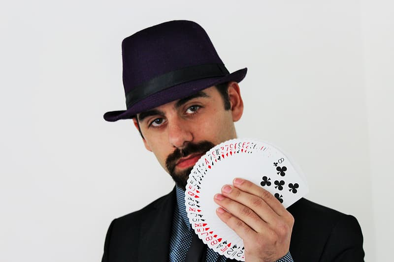 Man holding a playing cards