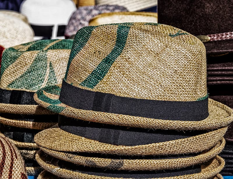 Brown and green fedora hats