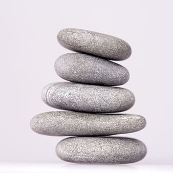 Stack of gray stone on white surface
