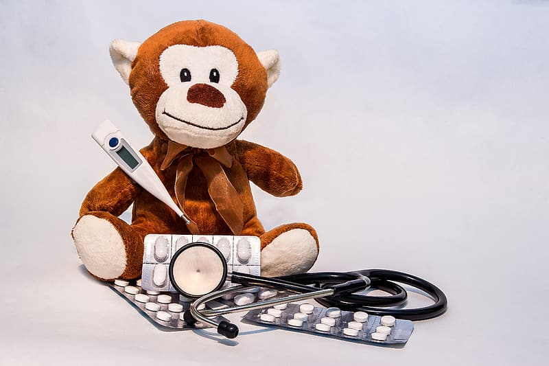 Brown monkey plush toy with assorted medical kit
