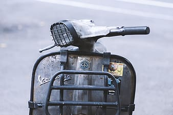 Selective photo of gray motor scooter