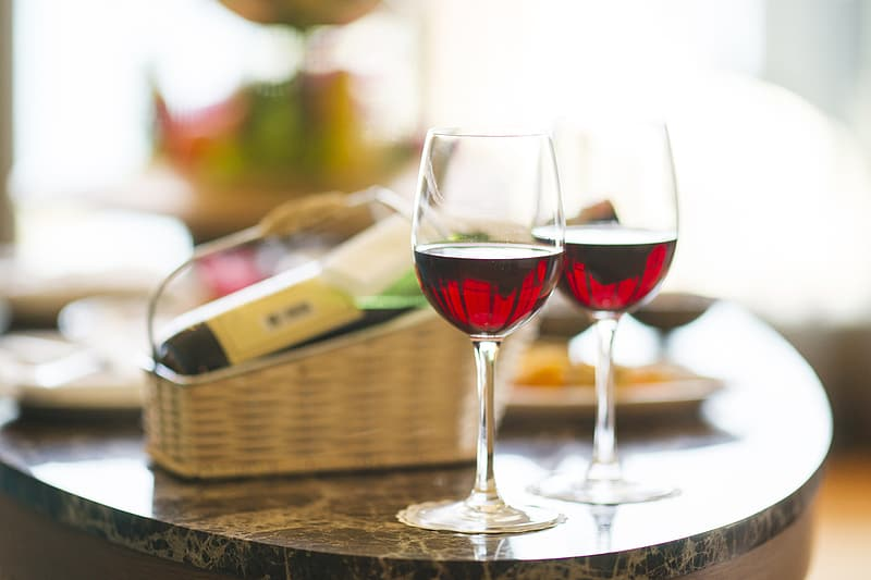 Two wine glasses filled with wine