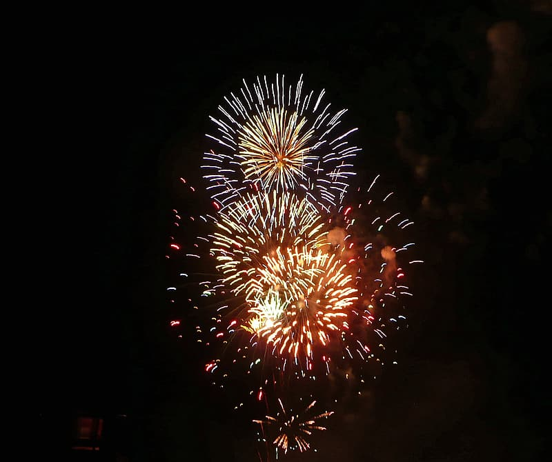 Red and yellow fireworks display during nighttime