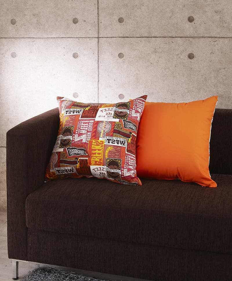 Throw pillows on suede couch
