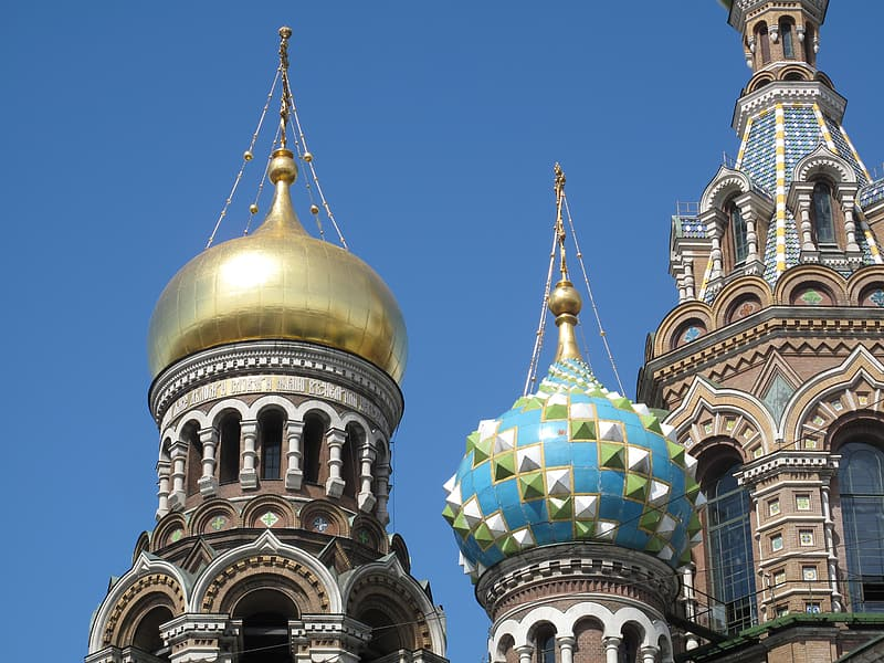 Gold and green dome temple under blue sky