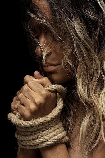 Woman holding brown rope