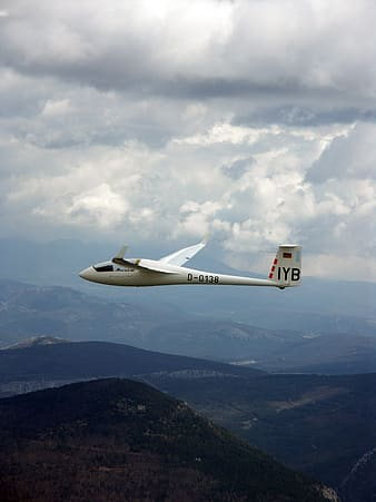 White monoplane in mid air