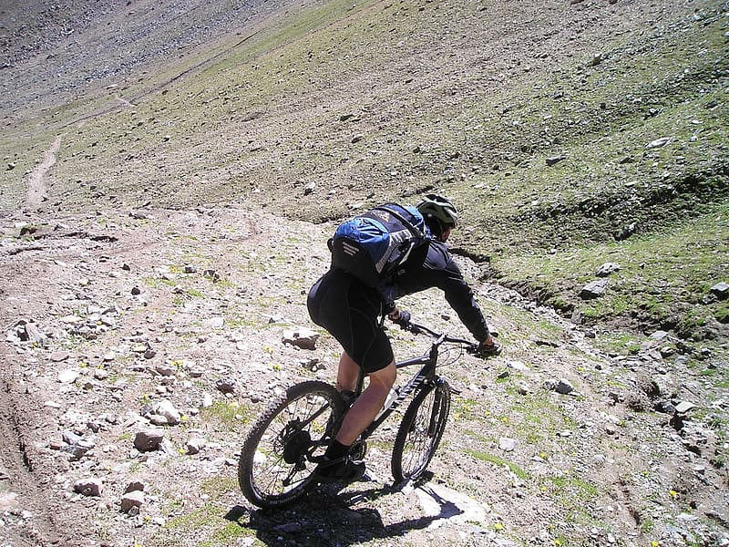 Man riding mountain bicycle on downhill