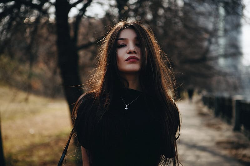 Woman wearing black turtle neck shirt in shallow focus photography