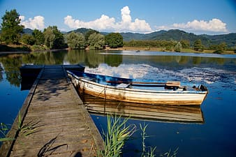 Empty boat docked on a body of water
