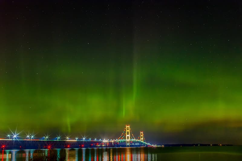 Blue and yellow long bridge with Aurora
