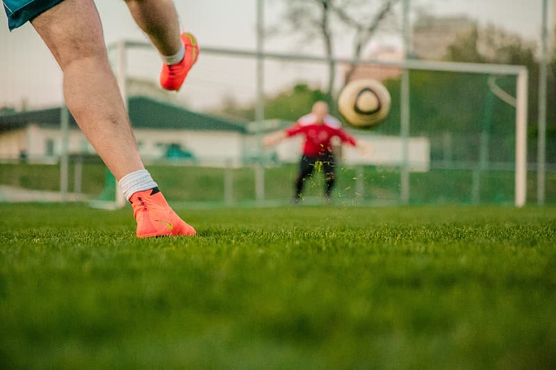 Man in red shirt playing soccer