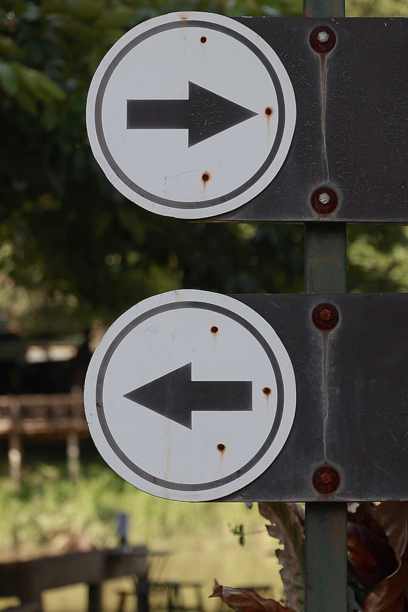 White and black arrow sign