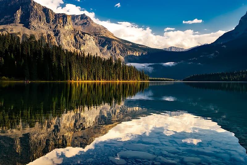 Landscape photo of body of water within mountain range