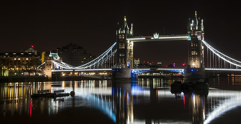 Lighted tower bridge at night time