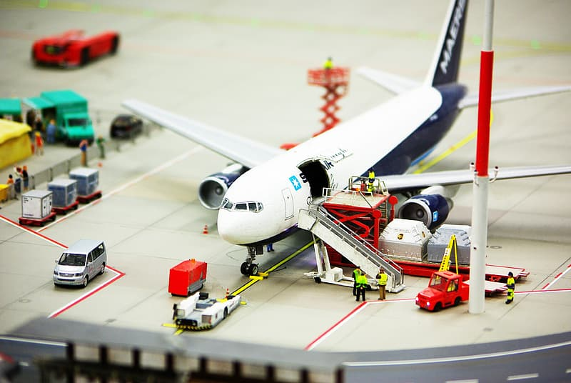 White and black Airliner scale model with car die-cast