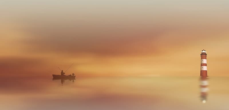 Silhouette of person riding on boat while fishing