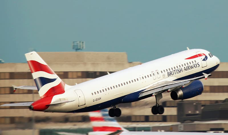 White British Airlines airplane flying