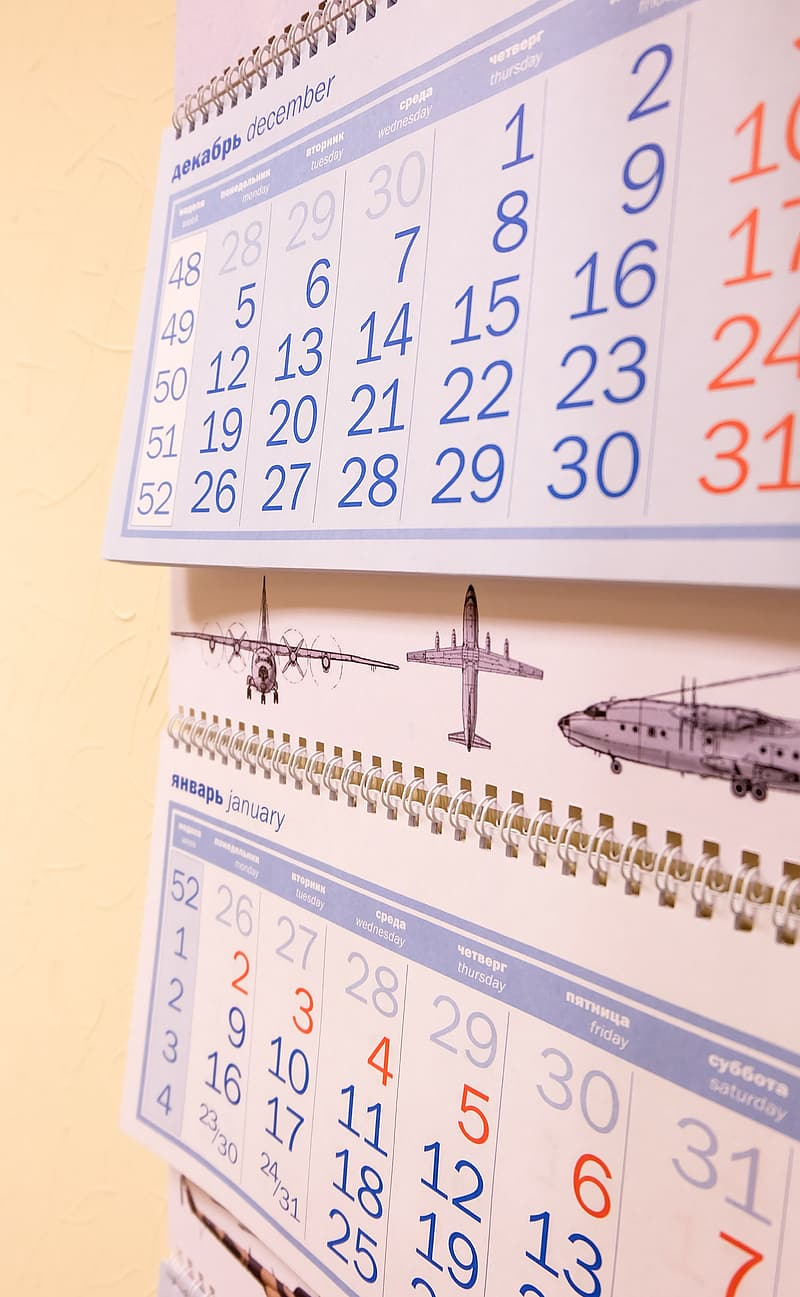White and black calendar on yellow wall