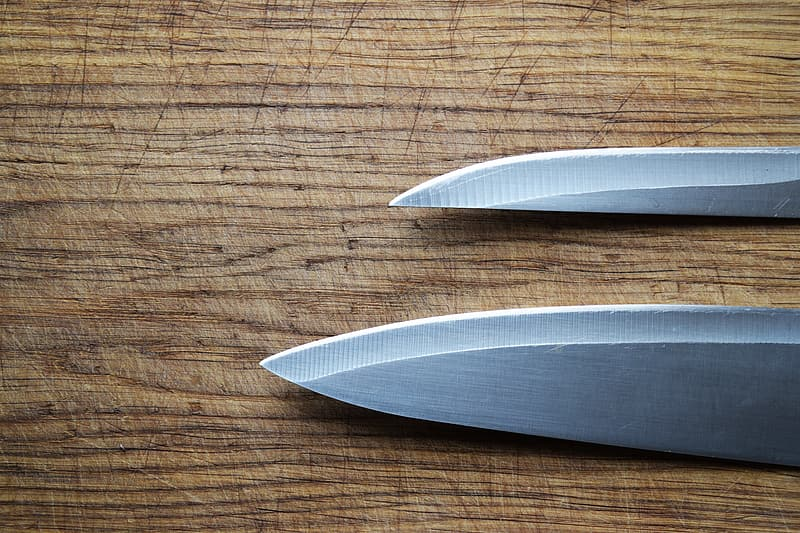 Two gray metal knives