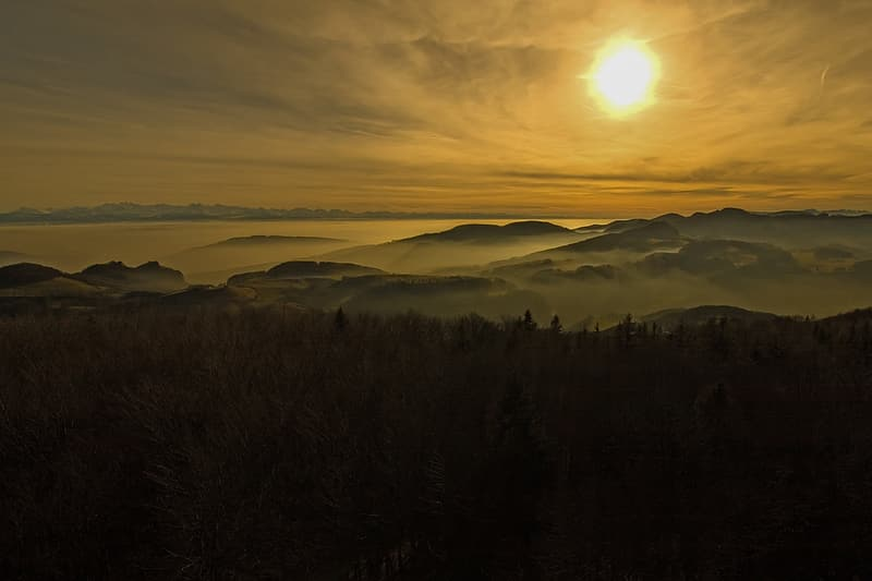 Mountain with fog during sunrise