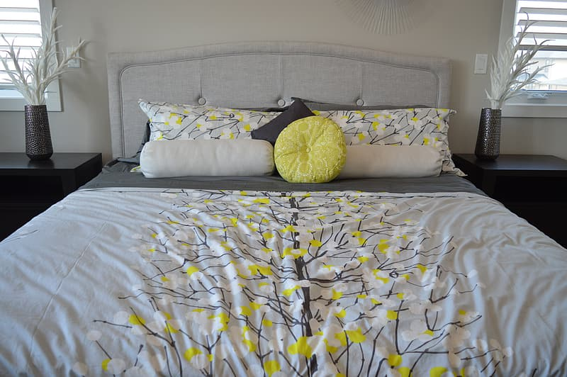 White and yellow bed sheet and pillow cases